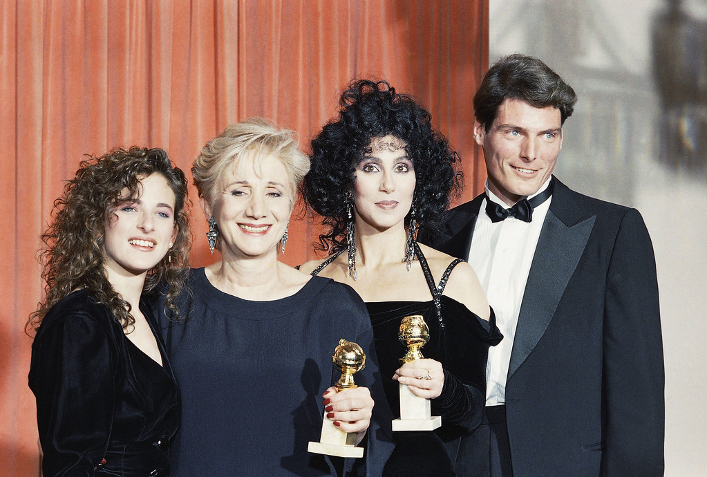 ". Winners of the Golden Globe Awards presented on Jan. 24, 1988 in Beverly Hills, Calif. are from left:  Marlee Matlin,  Olympia Dukakis, Cher; joined backstage by Christopher Reeve.  Dukakis won for ""Best Performance in a Supporting Role\"" and Cher, winner of the \""Best Performance by an Actress in a comedy\"", both appeared in movie \""Moonstruck.\""   (AP Photo/Reed Saxon)"