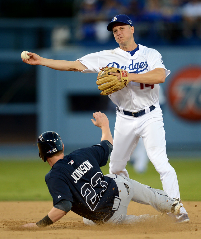 . Los Angeles Dodgers\' Mark Ellis outs Chris Johnson at second during a double play in the third inning during game 3 of the NLDS at Dodger Stadium Sunday, October 6, 2013. (Photo by Hans Gutknecht/Los Angeles Daily News)