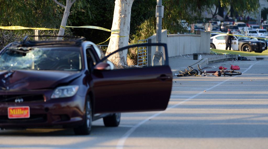 . Pomona Police and California State University Police investigate the scene of a fatality after a car struck a bicyclist Thursday, February 28, 2013, on Kellogg Drive at Cal Poly Pomona in Pomona.  (Staff photo/Inland Valley Daily Bulletin)