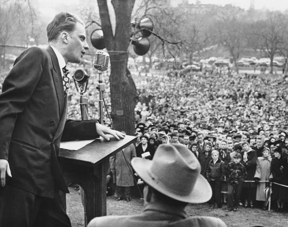 . The Rev. Billy Graham, crusading Evangelist, climaxed his tour of New England with a mass rally on historic Boston Common on April 23, 1950. Despite the cold weather, police estimated that 50,000 persons attended the event. (AP Photo)