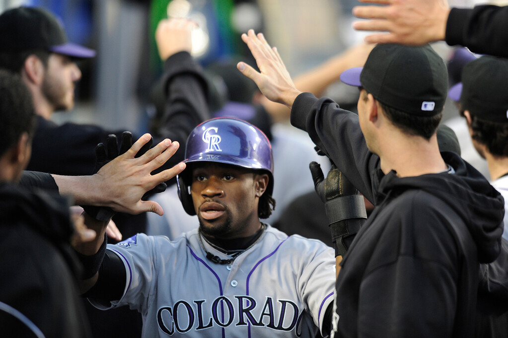 . Rockies Eric Young is congratulated after scoring in the 1st inning. The Los Angeles Dodgers played host to the Colorado Rockies in a game at Dodger Stadium in Los Angeles, CA 5/1/2013(John McCoy/Staff Photographer)