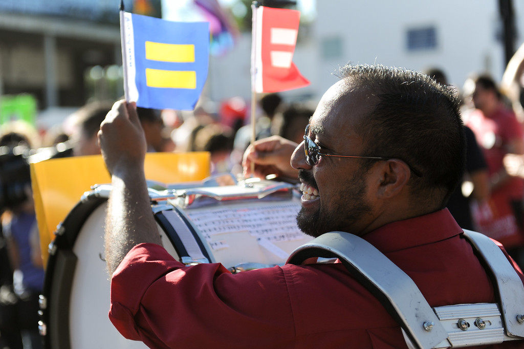 . Robert Gamboa with flags and his drum at the rally in West Hollywood to celebrate the U.S. Supreme Court\'s ruling that killed Prop 8, Wednesday, June 26, 2013. (Michael Owen Baker/L.A. Daily News)
