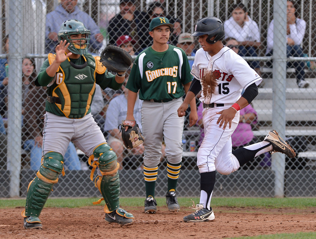. 0507_SPT_TDB-L-NARB-BANN--20130506-- Photo: Robert Casillas / LANG     Bannning defeated visiting Narbonne 8-2 to clinch share of Marine League baseball title. Bannings Juan Gallardo comes home to score as Narbonne catcher Isaac Lepe waits for throw as pitcher Daniel Rocha stands by.