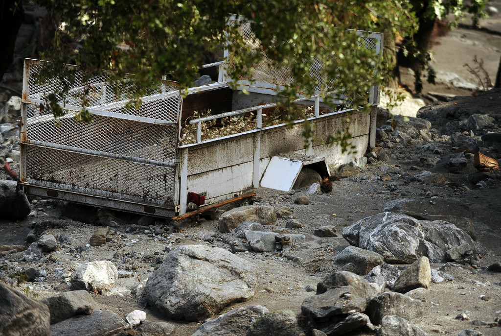 . Clean-up efforts take place after Sunday\'s storm caused flooding on Monday, August 4, 2014 in Forest Falls, Ca. (Micah Escamilla/San Bernardino Sun)