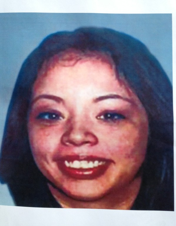 . (John Valenzuela/Staff Photographer)  A photo of Sylvia Flores, a 23-year-old woman from Perris, CA. who\'s body was found in a orange groves near Citrus Plaza shopping center in Redlands. Redlands Police released a composite sketch of the murder suspect.