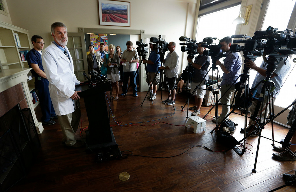 . Dr. David Mcray speaks about his friend and colleague Dr. Kent Brantly during a news conference Monday, July 28, 2014, in Fort Worth, Texas. Brantly is one of two American aid workers that have tested positive for the Ebola virus while working to combat an outbreak of the deadly disease at a hospital in Liberia. (AP Photo/LM Otero)