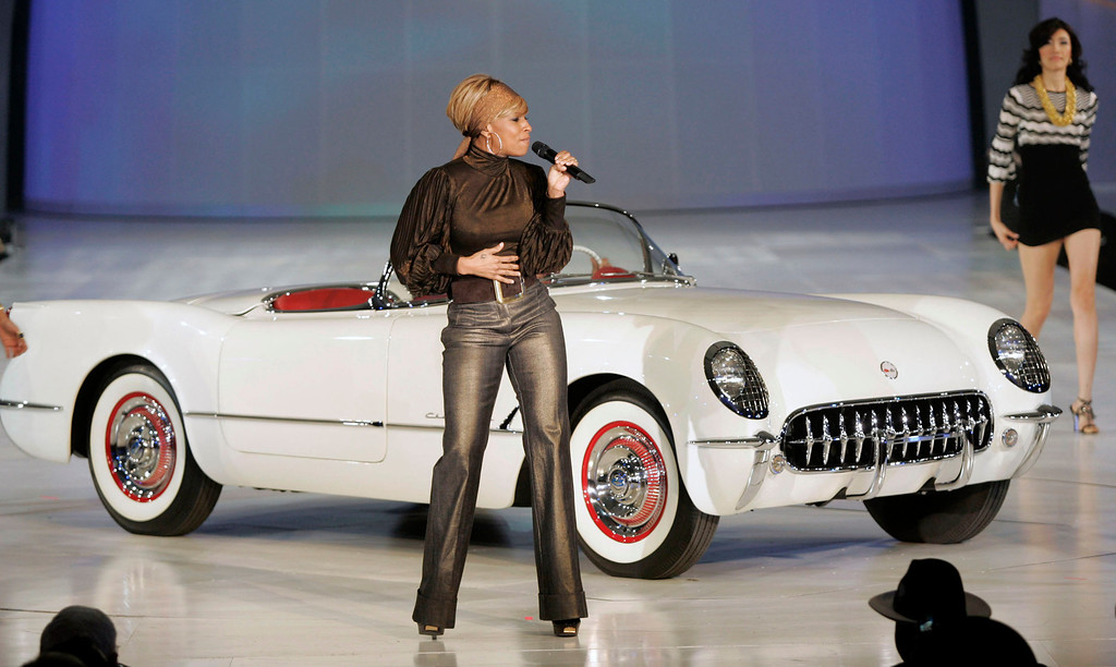 . DETROIT - JANUARY 12:  In this handout image provided by General Motors, singer Mary J. Blige performs next to a 1953 Chevrolet Corvette during the General Motors Style event the night before the press preview of the 2008 North American International Auto Show January 12, 2008 in Detroit, Michigan. The NAIAS is the world\'s largest auto show. Celebrities attending the GM event included Kid Rock, Maroon 5, Adrien Brody and Nick Cannon.  (Photo by John F. Martin/General Motors via Getty Images)