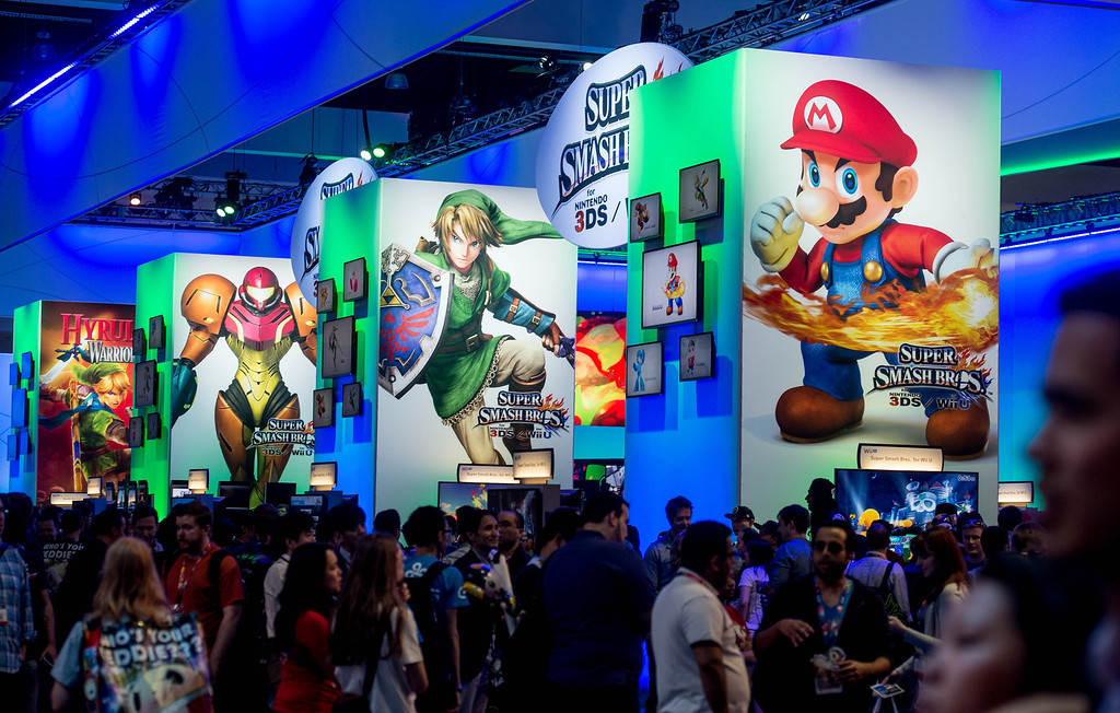 """. Attendees interact with the\""""Super Smash Bros\"""" video game at the Nintendo booth at the Electronic Entertainment Expo in Los Angeles on Tuesday, June 10, 2014. (Photo by Watchara Phomicinda)"""