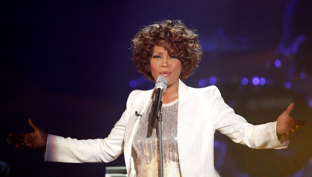 """. Singer Whitney Houston performs during the German game show  \""""Wetten Dass...?\""""  (Bet it...?)  in Freiburg, southwestern Germany, Saturday, Oct. 3, 2009.   (AP Photo/Johannes Eisele, Pool)"""