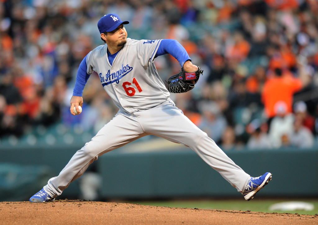 . Los Angeles Dodgers starting pitcher Josh Beckett delivers against the Baltimore Orioles in the first inning of the second baseball game of a doubleheader, Saturday, April 20, 2013, in Baltimore. Orioles won 6-1.   (AP Photo/Gail Burton)