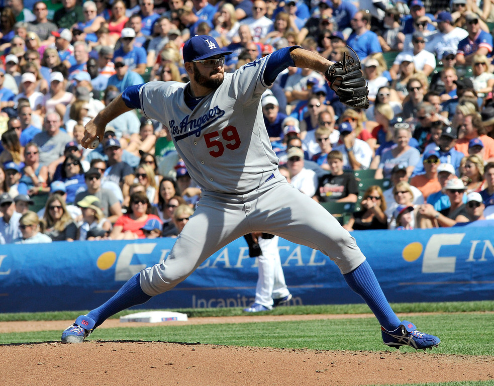 . Los Angeles Dodgers pitcher Stephen Fife throws a pitch in the fourth inning of a baseball game between the Chicago Cubs and the Los Angeles Dodgers Sunday Aug. 4, 2013 in Chicago, Ill. (AP Photo/Joe Raymond)