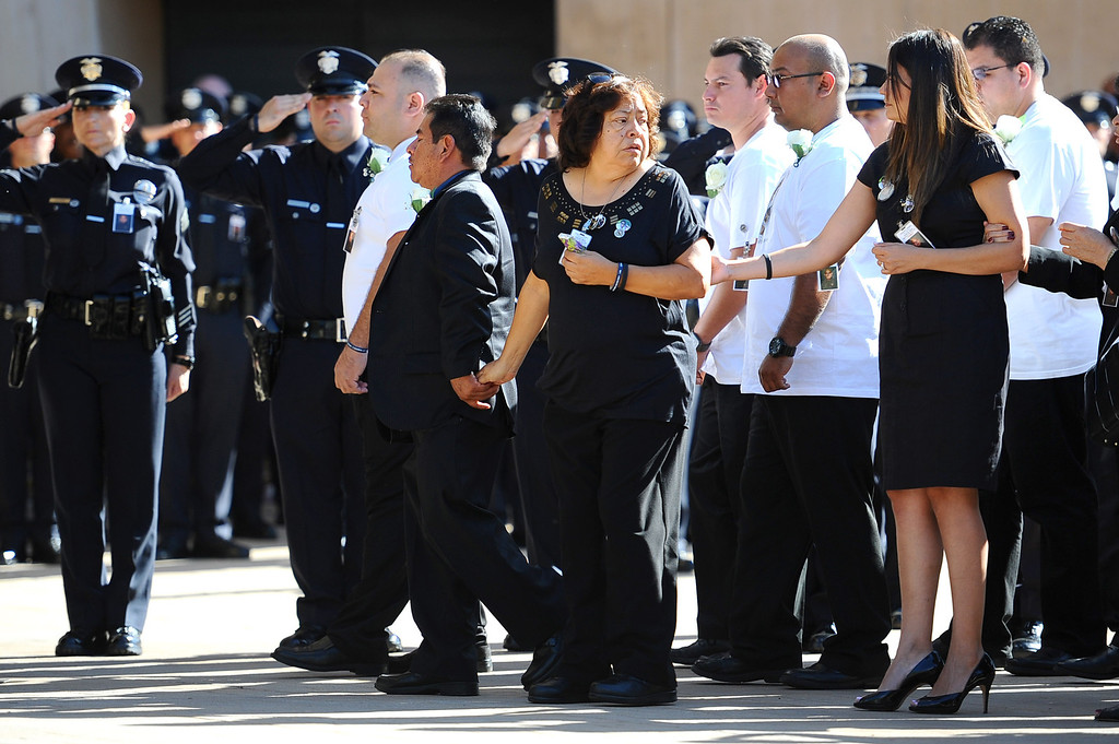 . Family members make their way into the church for the funeral of LAPD Officer Roberto Sanchez at the Cathedral of Our Lady of the Angels in Los Angeles, CA May 14, 2014.  Sanchez was killed in a hit-and-run crash involving a SUV driver who is accused of deliberately ramming the officer\'s patrol car in Harbor City.(Andy Holzman/LA Daily News)