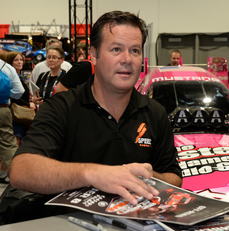 . Nov 6,2013 Las Vegas NV. USA. Off road racer Robby Gordon sign autographs at the Traxxas booth,  during the second day of the 2013 SEMA auto show.