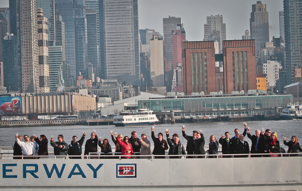 """. Survivors of U.S. Airways Flight 1549 with155 passengers and crew, including Captain Chesley \""""Sully\"""" Sullenberger III, who piloted safe water landing 5 years ago, join with their rescuers in a toast marking the anniversary of the event known as the \""""miracle on the Hudson,\"""" on Wednesday, Jan. 15, 2014 in New York.  (AP Photo/Bebeto Matthews)"""