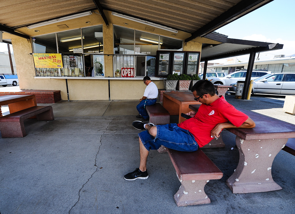 . Customers wait for their Mexican food orders at Rosa Maria\'s in San Bernardino Wednesday, Sept. 4, 2013. Locals consider Rosa Maria\'s a San Bernardino food hotspot in town. (Photo by Rachel Luna / San Bernardino Sun)