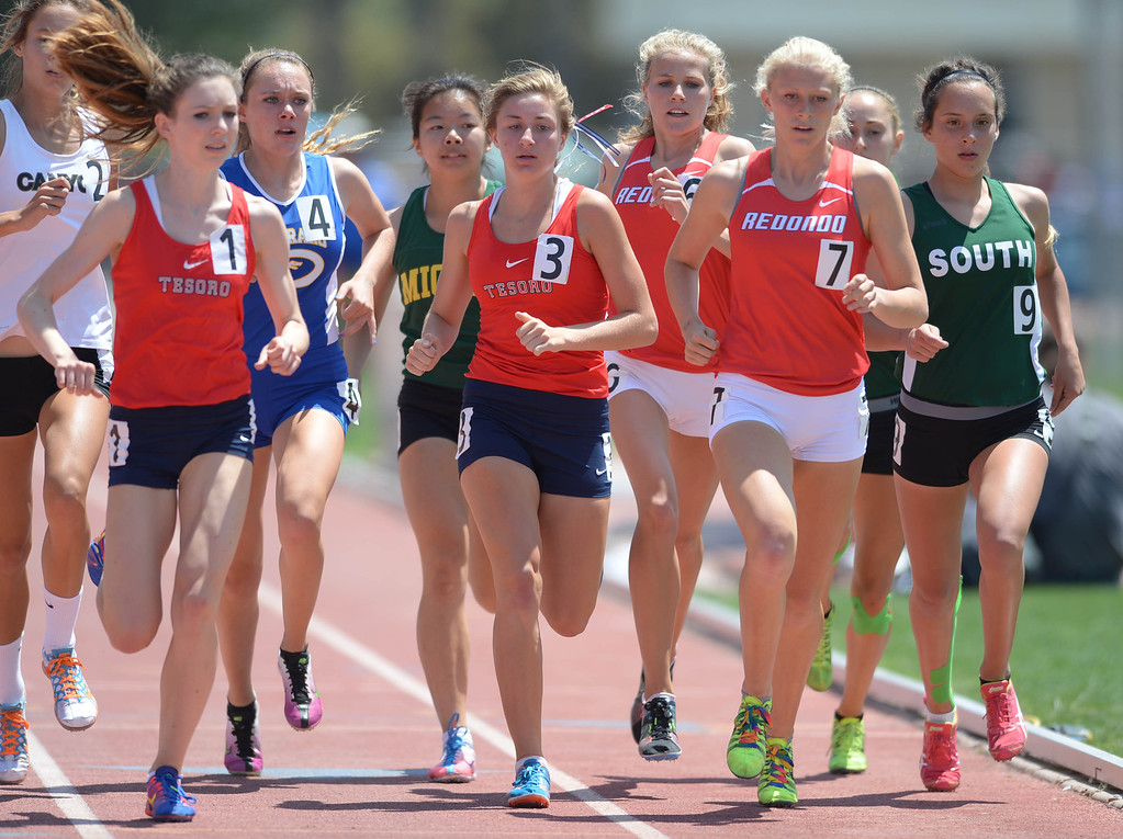 . Redondo\'s Kayla Ferron (7) begins making her move to the front of the pack in the 1600 meters Division 2 race of the CIF Southern Section Track and Field Championships Saturday at Mt. SAC. South\'s Taylor Beaudoin takes the inside lane. Ferron was the race winner. 20130518 Photo by Steve McCrank / Staff Photographer