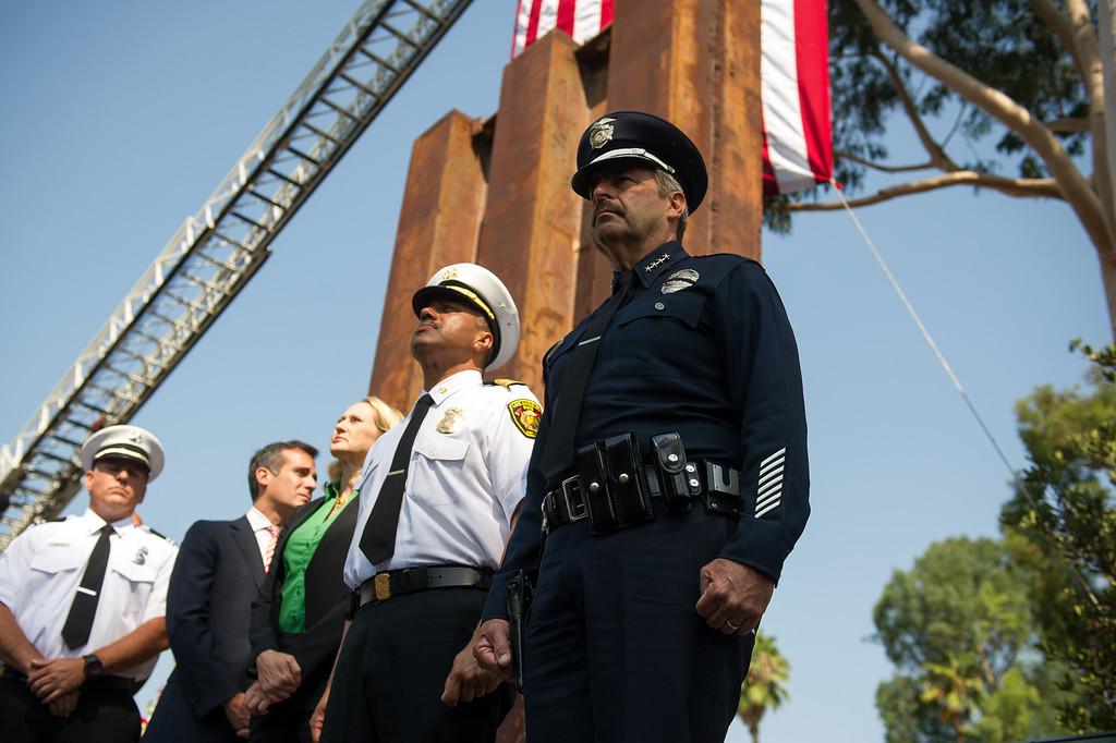 . Dignitaries stand during the playing of Taps at the 9/11 Remembrance Ceremony at the World Trade Center Memorial at LAFD Frank Hotchkin Memorial Training Center, Thursday, September 11, 2013. (Photo by Michael Owen Baker/L.A. Daily News)