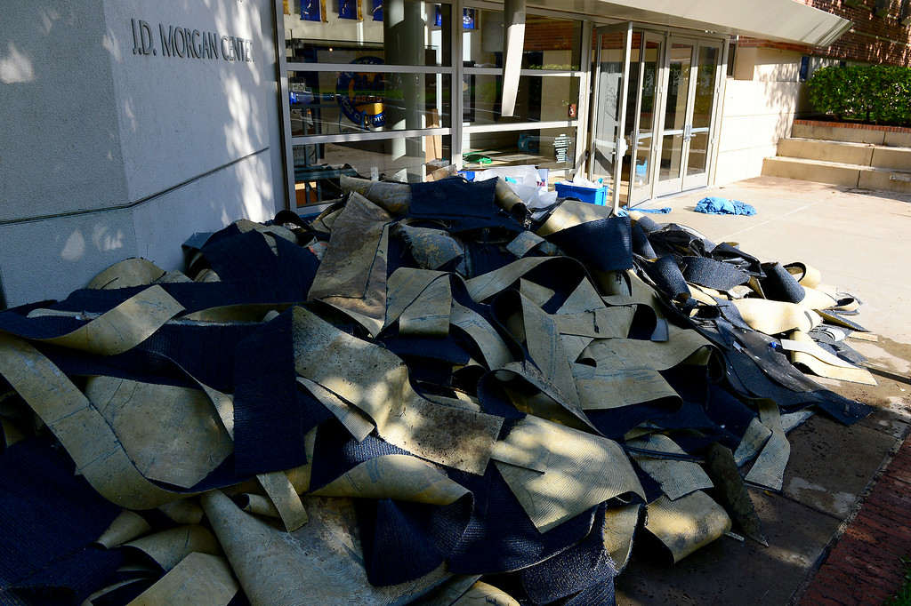 . Soggy carpet is piled outside the J.D. Morgan Center at UCLA, Wednesday, July 30, 2014. (Photo by Michael Owen Baker/Los Angeles Daily News)