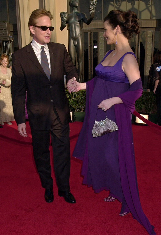 ". Actor Michael Douglas looks at his pregnant wife, Catherine Zeta-Jones as they walk down the red carpet at the 9th annual Screen Actors Guild awards in Los Angeles, Sunday, March 9, 2003. Zeta-Jones won outastanding performance in a supporting role for her role in the film ""Chicago.\"" (AP Photo/Kim D. Johnson)"