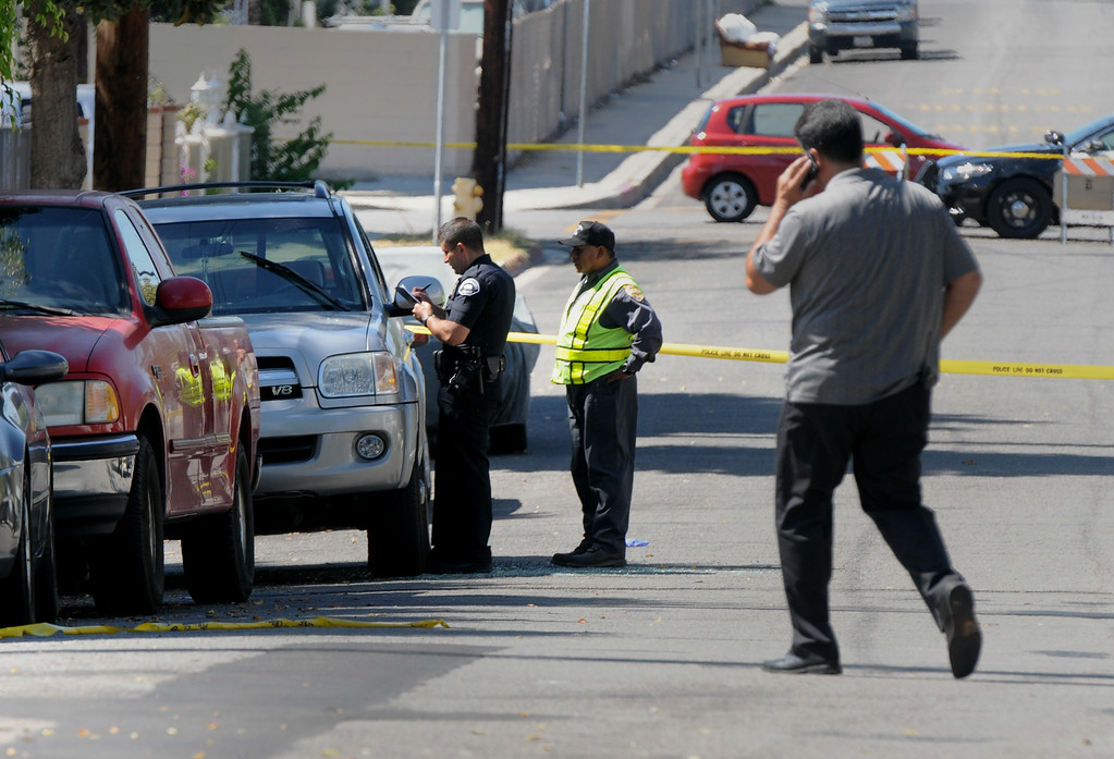 . San Fernando police investigate the scene of a shooting where one was killed and two were injured in the 1400 block of Celis Street on August 24, 2014.  Describing what they called �a major public threat,� Los Angeles police said they are seeking clues to three separate shootings in the Northeast San Fernando Valley that left three people dead and four others injured early Sunday morning and appear to be connected. The three incidents, which were described as having �a similar manner,� took place between 5:50 and 6:45 a.m. Sunday in the city of San Fernando and in the Los Angeles communities of Sylmar and Pacoima, Los Angeles Police Department officials said. (Photo by Dean Musgrove/Los Angeles Daily News)
