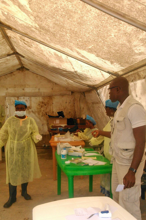 . In this photo taken on Sunday, July 27, 2014,  medical personnel work at the Doctors Without Borders facility in Kailahun, Sierra Leone where Dr. Sheik Humarr Khan died. A leading doctor who risked his own life to treat dozens of Ebola patients died Tuesday, July 29, 2014,  from the disease, officials said, as a major regional airline announced it was suspending flights to the cities hardest hit by an outbreak that has killed more than 670 people. Dr. Sheik Humarr Khan, who was praised as a national hero for treating the disease in Sierra Leone, was confirmed dead by health ministry officials there. He had been hospitalized in quarantine. (AP Photo/ Youssouf Bah)
