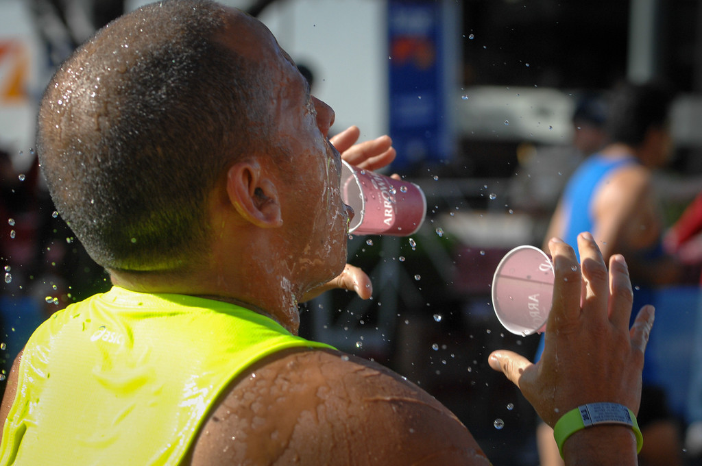 . Marathon runners douse themselves with water on Santa Monica Boulevard in Beverly Hills during the Los Angeles Marathon, Sunday, March 9, 2014. (Photo by Michael Owen Baker/L.A. Daily News)