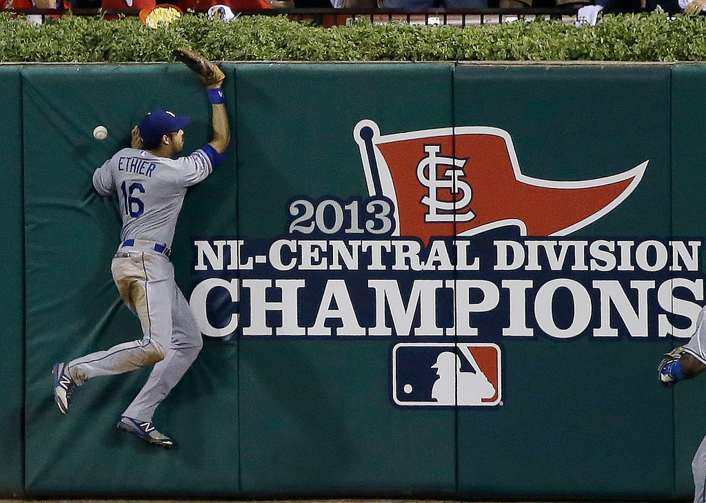 . Los Angeles Dodgers\' Andre Ethier can\'t come up with a double by St. Louis Cardinals\' Carlos Beltran during the third inning of Game 1 of the National League baseball championship series Friday, Oct. 11, 2013, in St. Louis. (AP Photo/David J. Phillip)
