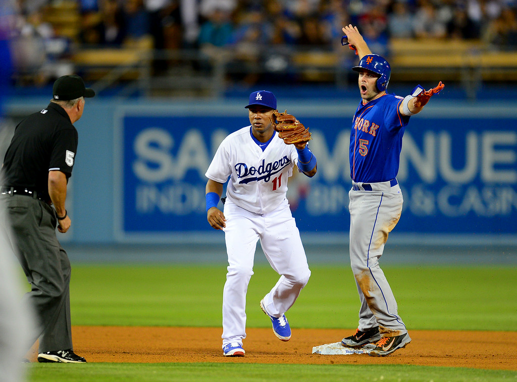 . The Mets\' David Wright reacts after being tagged out by Dodgers\' shortstop Erisbel Arruebarrena on a double play. (Photo by Michael Owen Baker/Los Angeles Daily News)