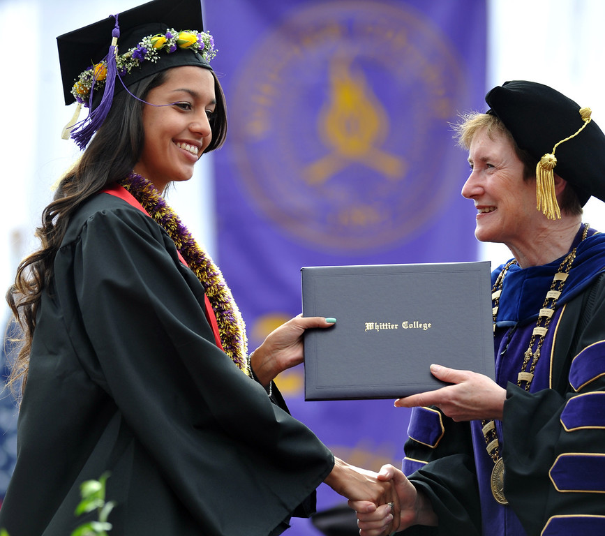 . Julie Duran receives her diploma from President Sharon Herzberger during the 110th Commencement Ceremony at Memorial Stadium on the Whittier College campus in Whittier on Friday May 17, 2013. Award-winning journalist Sonia Nazario gave the keynote address and received an honorary degree from the Whittier College faculty: a doctorate of humane letters.(SGVN/Staff Photo by Keith Durflinger)