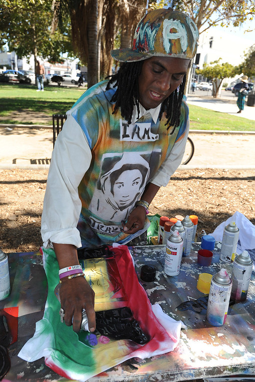 . Tony B.Conscious uses spray paint and stencils to create Trayvont-shirts at Leimert Park.  Crowds gather to protest while a heavy presence of Los Angeles Police Officers patrols the area around Leimert Park at the intersection of, Crenshaw Boulevard and Vernon in Los Angeles, CA. 7/16/2013(John McCoy/LA Daily News)