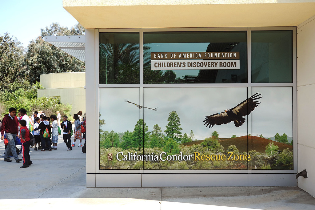 . Zoo visitors make their way by the California Condor Rescue Zone at the Los Angeles Zoo May 9, 2013.(Andy Holzman/Staff Photographer)