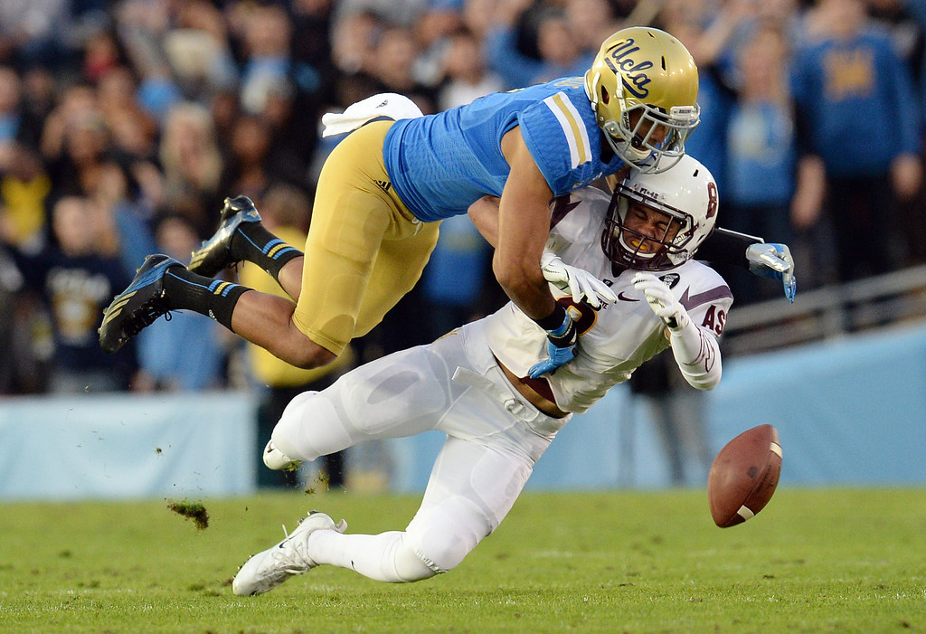 . UCLA�s Priest Willis #2 breaks up a pass intended for Arizona State�s D.J. Foster #8 during their game at the Rose Bowl Saturday November 23, 2013. (Photos by Hans Gutknecht/Los Angeles Daily News)