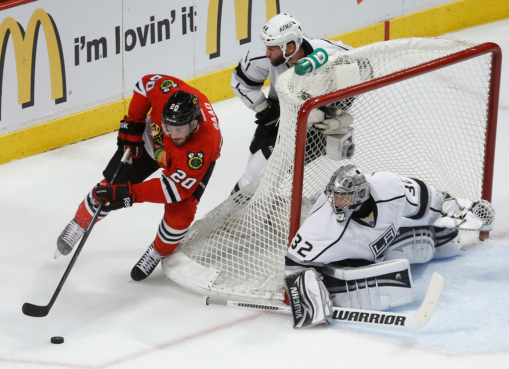 . Chicago Blackhawks left wing Brandon Saad (20) looks to score against Los Angeles Kings goalie Jonathan Quick (32) in the first period in Game 1 of the NHL hockey Stanley Cup Western Conference finals Saturday, June 1, 2013, in Chicago. (AP Photo/Charles Rex Arbogast)