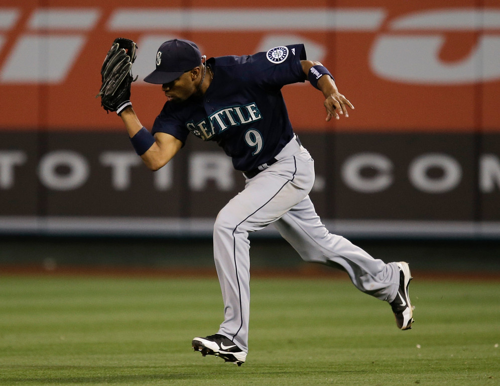 . Seattle Mariners\' Endy Chavez catches a ball hit by Los Angeles Angels\' Erick Aybar during the sixth inning of a baseball game in Anaheim, Calif., Tuesday, June 18, 2013. (AP Photo/Jae C. Hong)
