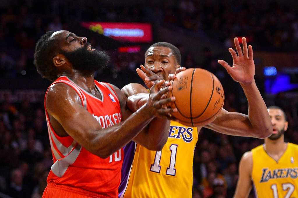 . Lakers� Wesley Johnson strips the ball from rockets� James Harden during first half action at Staples Center Wednesday, February 19, 2014. ( Photo by David Crane/Los Angeles Daily News )