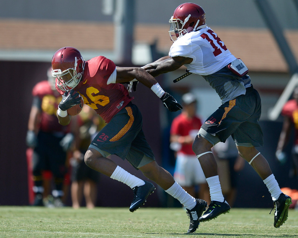 . James Toland IV runs past Quinton Powell. Football practice is in full swing on the Howard Jones Field at USC. Los Angeles, CA. 8/6/2014(Photo by John McCoy Daily News)