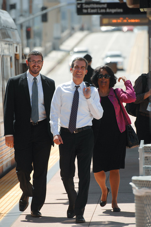. Eric Garcetti walks with former candidates Emanuel Pleitez and Jan Perry on a Gold Line metro stop in East Los Angeles during his Whistle Stop Tour of LA, Monday, May 20, 2013. Garcetti used the Expo, Gold and Red metro lines to greet voters in Los Angeles. (Michael Owen Baker/Staff Photographer)