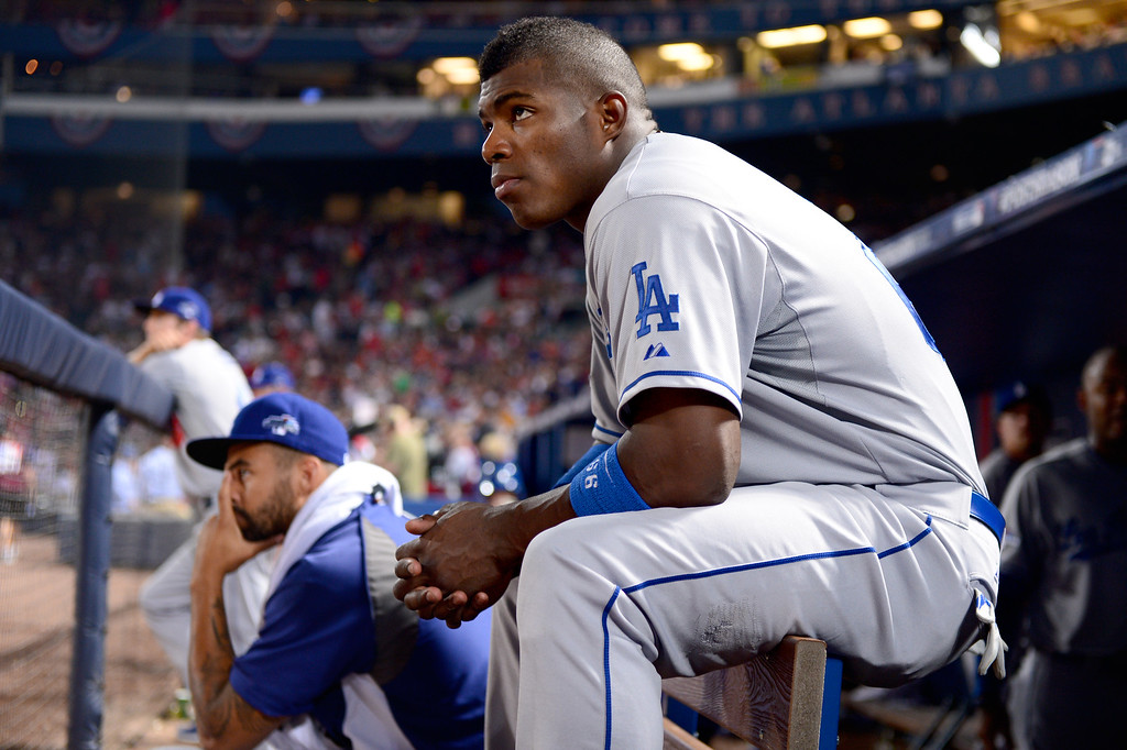 . Los Angeles Dodgers\' Matt Kemp and Yasiel Puig keep their eyes on game 2 of the playoffs Thursday, October 4, 2013 at Turner Field in Atlanta, Georgia. Braves defeated the Dodger 4-3. (Photo by Sarah Reingewirtz/Pasadena Star- News)
