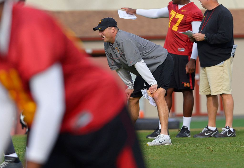 . Interim head coach Clay Helton watches a play during USC\'s final practice of the 2013 season December 18, 2013 in Los Angeles, CA.  The team flies to Las Vegas to play Fresno State in the Las Vegas Bowl on December 21, 2013.(Andy Holzman/Los Angeles Daily News)
