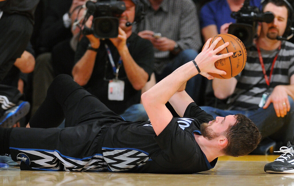. Timberwolves Kevin Love holds the ball after getting fouled in the first half, Friday, December 20, 2013, at Staples Center. (Photo by Michael Owen Baker/L.A. Daily News)