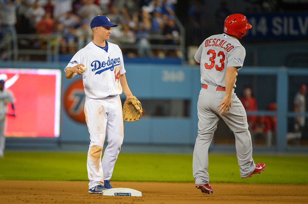 . Cardinals\' Daniel Descalso is out at second as Dodgers\' Mark Ellis caught him between bases in NLCS game 3 at Dodger stadium Monday, October 14, 2013 ( Photo by Andy Holzman/Los Angeles Daily News )