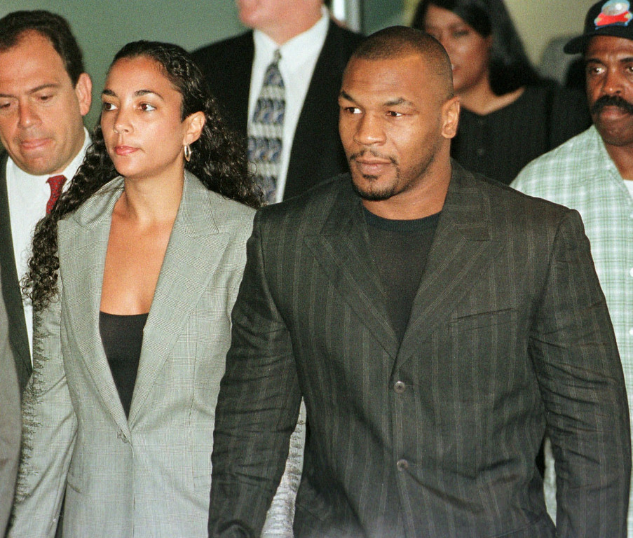 . Boxer Mike Tyson walks with his wife, Dr. Monica Tyson, as they arrive for a hearing before the New Jersey Athletic Control Board in Trenton, N.J., Wednesday, July 29, 1998 to determine if Tyson can return to boxing in the state. Tyson refused to read a prepared statement saying he was angry after answering questions about biting Evander Holyfield\'s ear in their June 28, 1997 title bout. (AP Photo/Dan Hulshizer)
