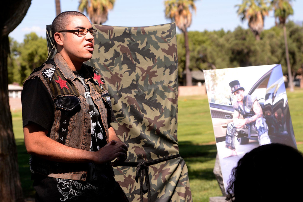""". Boaz Lewis, 20, speaks during a tribute for his father Charles \""""Mask\""""  Lewis Jr. at Mountain View Cemetery in San Bernardino, CA on Saturday September 7, 2013.  (Photo by Gabriel Luis Acosta/San Bernardino Sun)"""