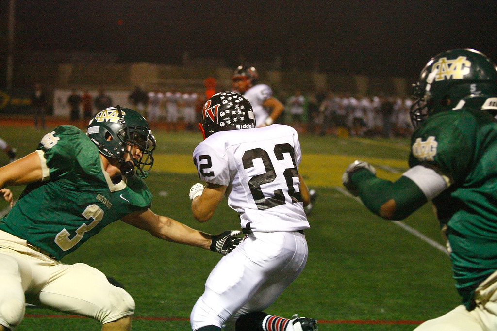 . Stanton Gilbertson #22 of Palos Verdes runs with the ball against the defense of Mira Costa in a Bay League matchup at Mira Costa High School on Friday, October 18, 2013 in Manhattan Beach, Calif.  (Michael Yanow / For the Daily Breeze)