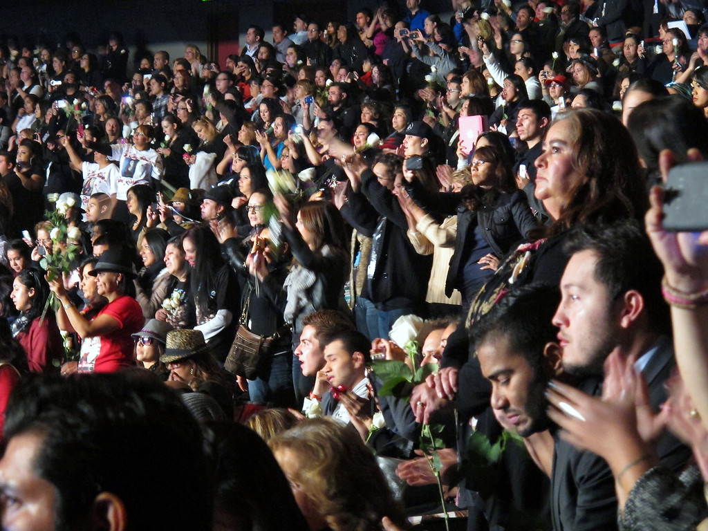 . Jenni Rivera fans wave during a song at her memorial service at the Gibson Amphitheatre Wednesday, December 19, 2012, in Universal City. (Michael Owen Baker/Los Angeles Daily News)