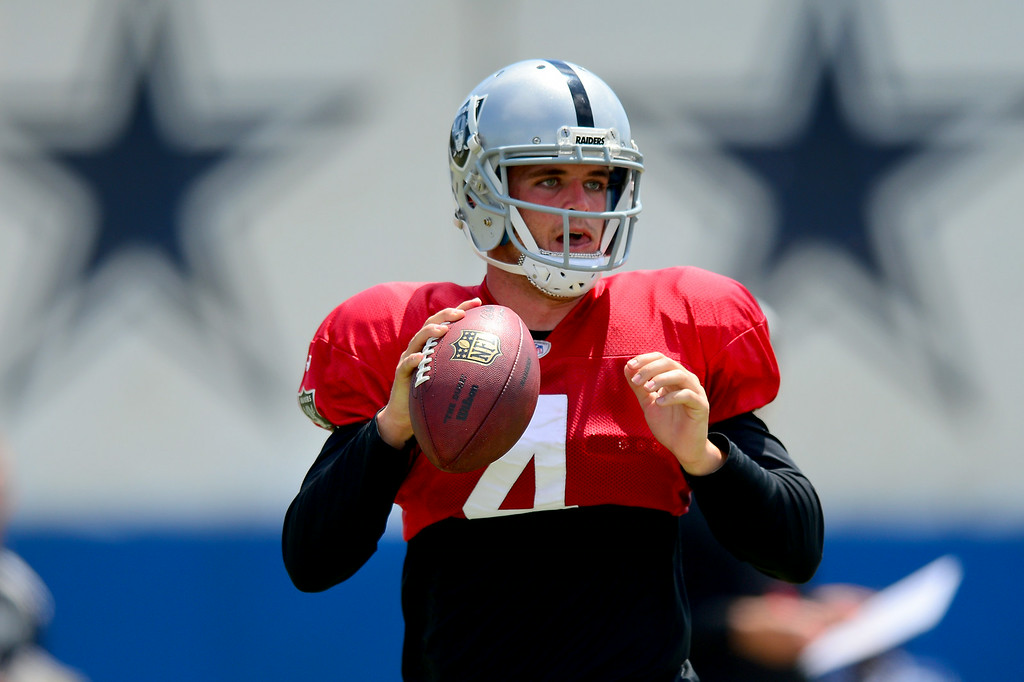 . Raider QB Derek Carr, a rookie from Fresno State, rolls out of the pocket at the Cowboys-Raiders practice in Oxnard, Wednesday, August 13, 2014. (Photo by Michael Owen Baker/Los Angeles Daily News)