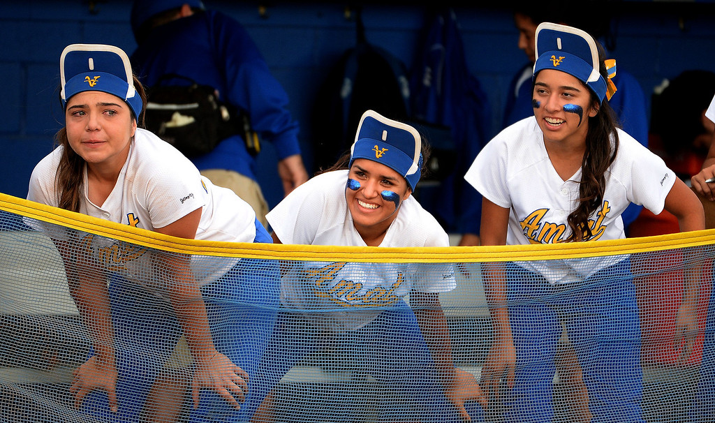. Bishop Amat bench wears their rally caps in the seventh inning of a prep playoff softball game against La Serna at Bishop Amat High School in La Puente, Calif., on Thursday, May 22, 2014. La Serna won 6-0.   (Keith Birmingham/Pasadena Star-News)