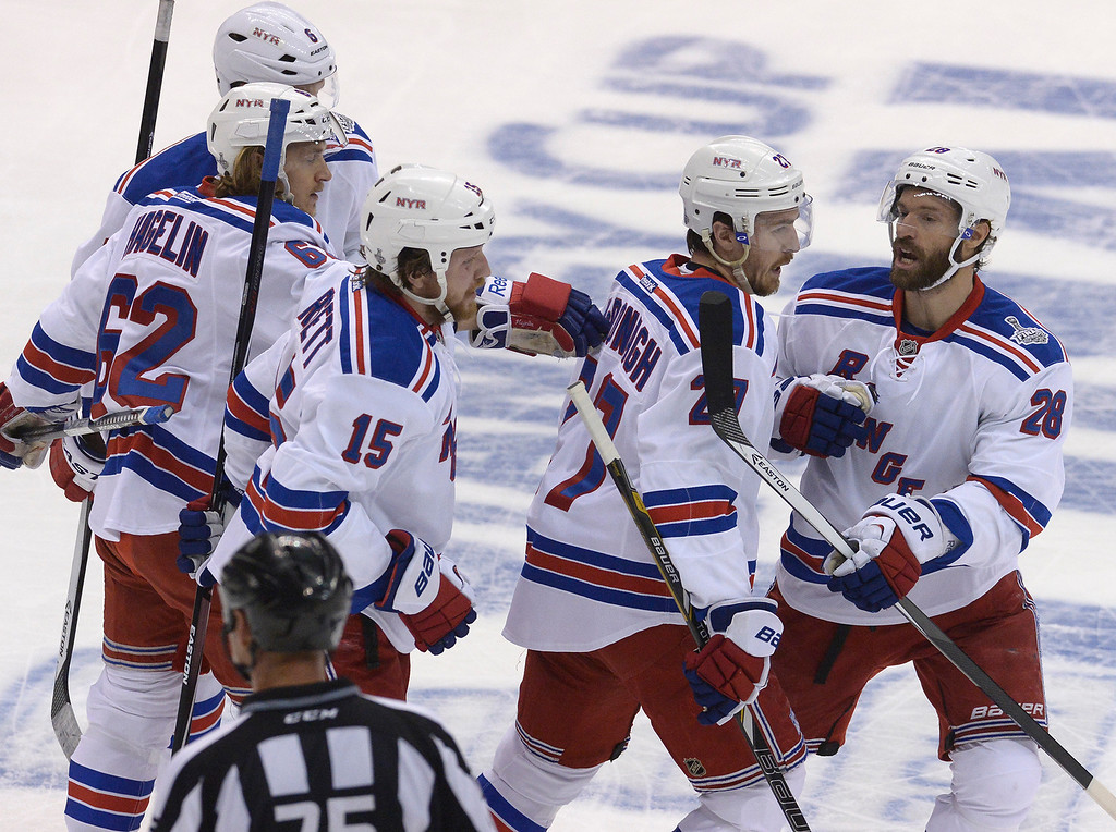 . The Rangers celebrate after Rangers#27 Ryan McDonagh scored the first goal of the game in the first period. The Los Angeles Kings faced the New York Rangers in game 2 of the Stanley Cup Final.  Los Angeles, CA. 6/7/2014(Photo by John McCoy Daily News)