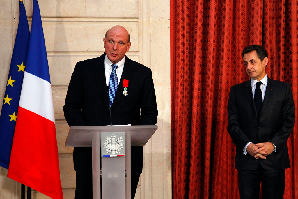 . Microsoft CEO, Steve Ballmer, left, delivers his speech at the Elysee Palace after he was awarded Knight of the Legion of Honor by France\'s President Nicolas Sarkozy, right, in Paris, Wednesday, Feb. 16, 2011. (AP Photo/Francois Mori, Pool)