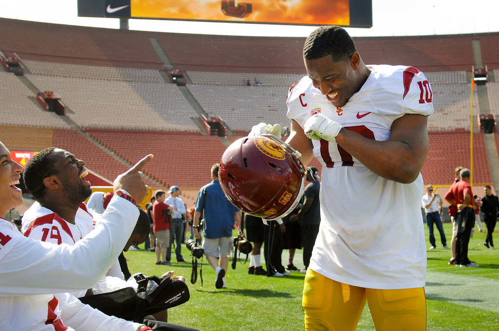 . USC LB Hayes Pullard, right, jokes with Su\'a Cravens and Michael Hutchings on the sidelines during the spring game. (Photo by Michael Owen Baker/L.A. Daily News)